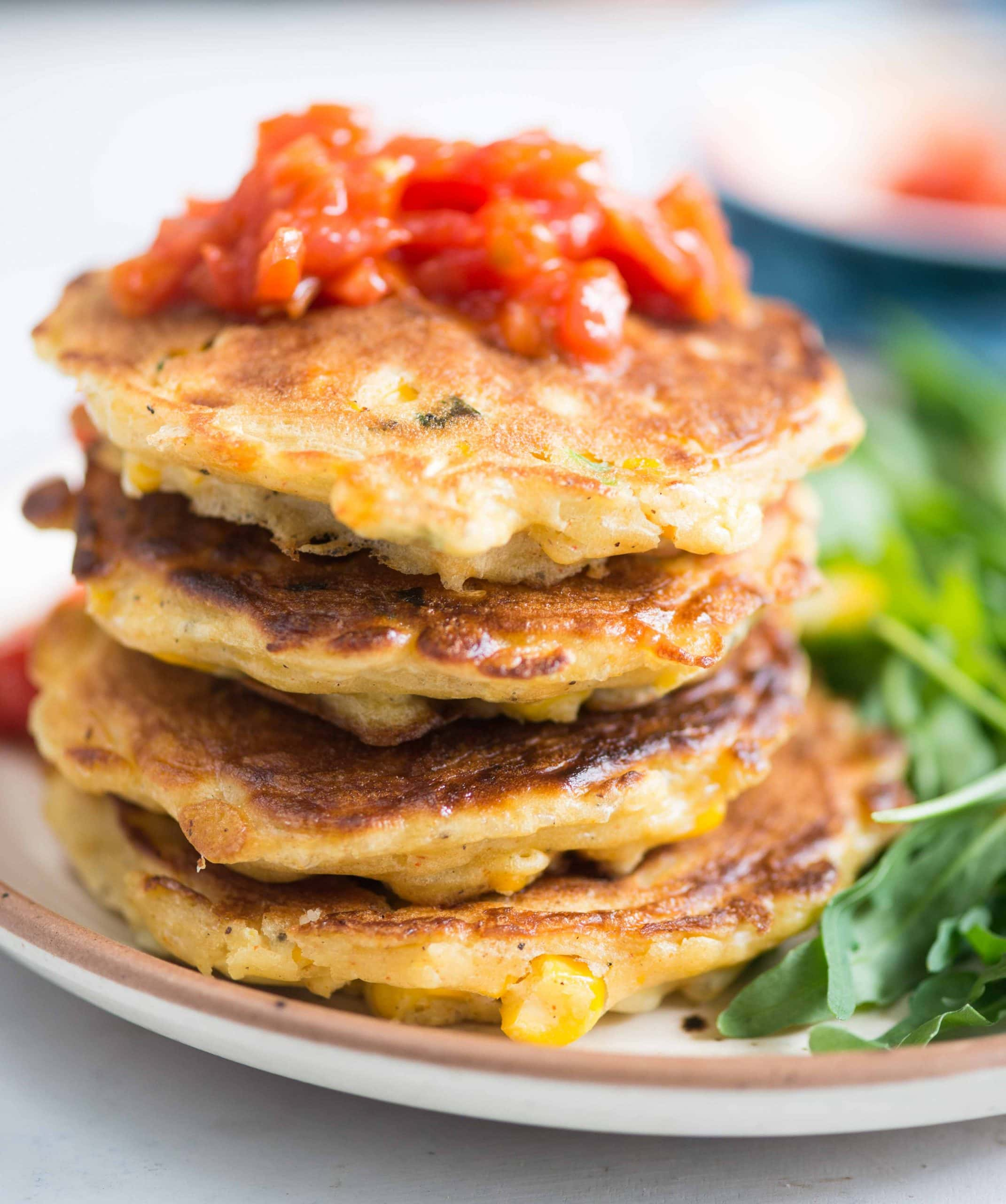 Cheesy corn fritters served with tomato salsa