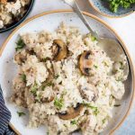Creamy Chicken and rice with roasted mushrooms is a one-pot dinner that is hearty and comforting. Caramelized mushroom adds so much flavour to the dish and makes a perfect family-friendly dinner.