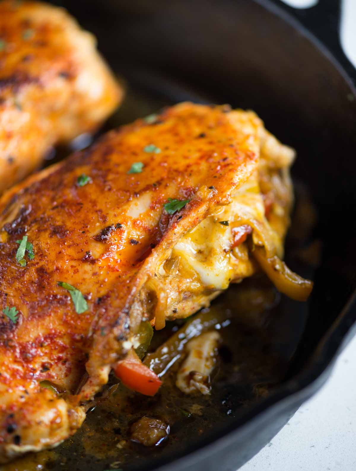 Fajita Stuffed Chicken breast is a different take on Chicken Fajita. Chicken breast is stuffed with Caramelized and crunchy peppers, onion, Mexican seasoning, and cheese, then baked to perfection.
