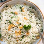 Garlic butter rice with a subtle flavor from parsley, this is a perfect side dish to serve. The rice is perfectly seasoned and smells heavenly of garlic butter.