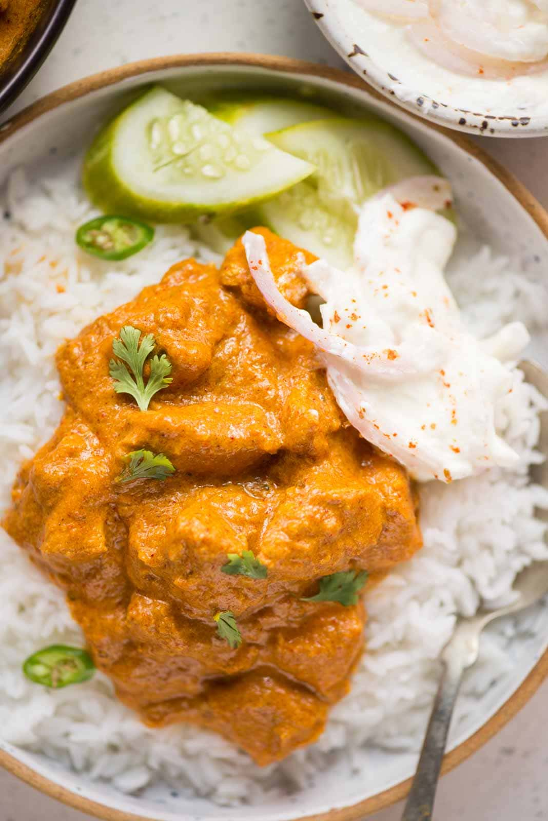 Coconut Chicken Curry, Chicken slow-cooked in sauteed onion, ginger garlic, spices, and coconut milk until juicy and tender. Perfect to pair with rice or roti/naan.