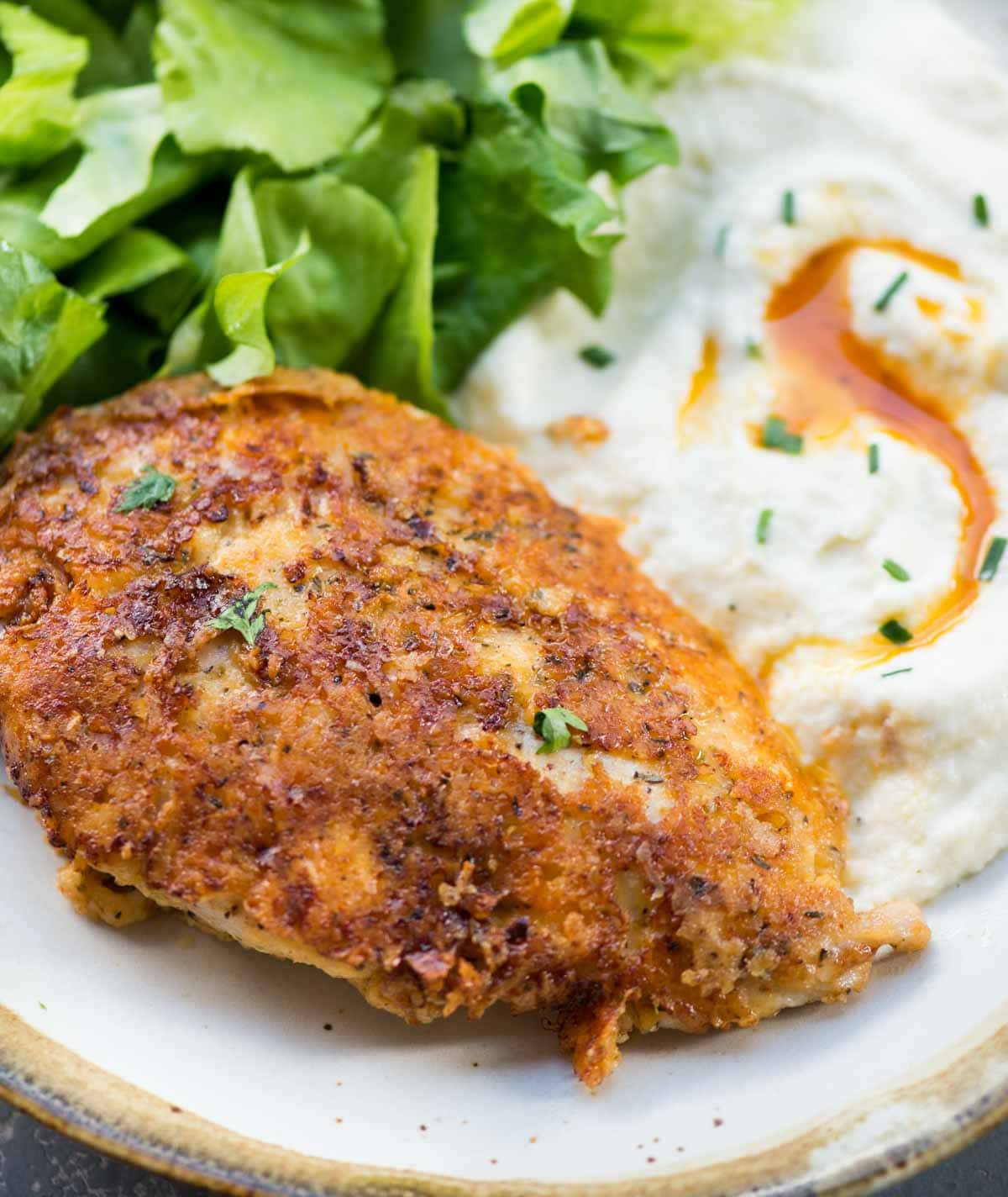 Perfectly crispy Parmesan Crusted Chicken recipe is an easy low carb chicken dinner made in just 15 minutes. Chicken coated with mayo for extra moist chicken, breaded with parmesan, and pan-fried.