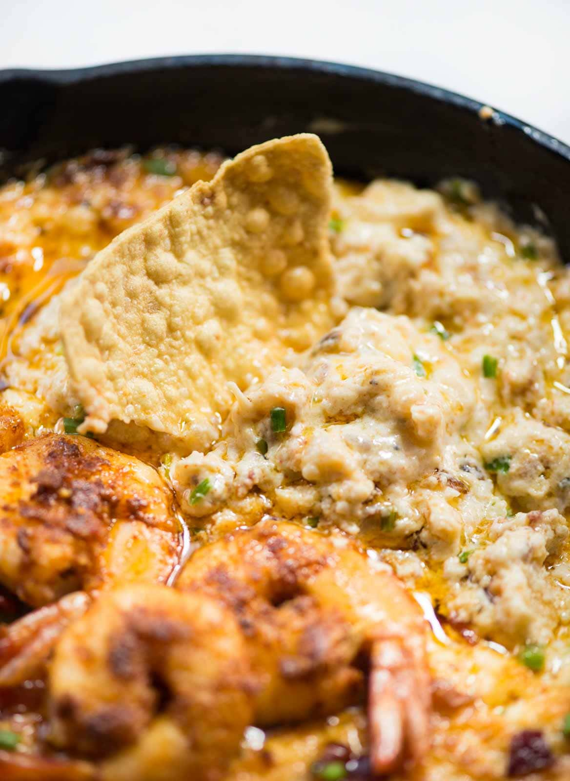 his cheesy hot Shrimp Dip with Bacon with juicy shrimp and three types of cheese is a showstopper on your party appetizer menu. Hot Bubbly shrimp dip is also Keto and low carb.