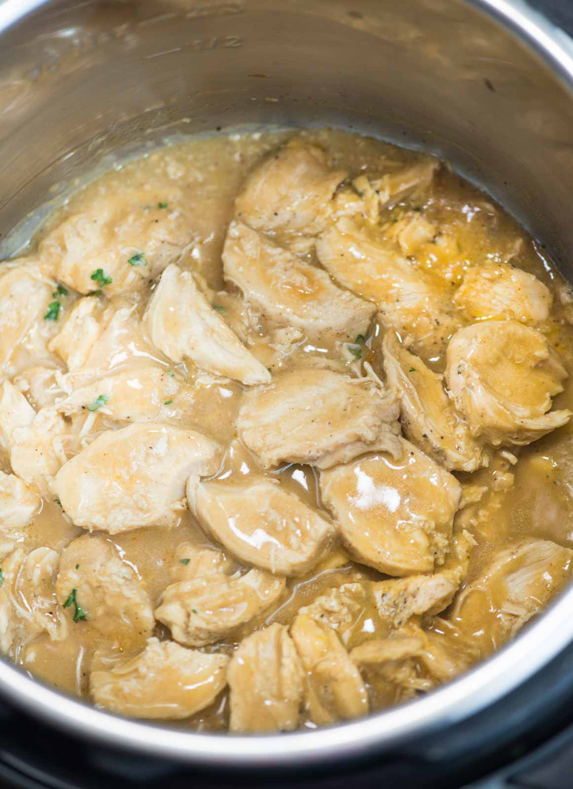 Chicken and gravy made in the Instant pot have tender chicken breast and creamy thick gravy made from scratch. Made totally from scratch without any gravy mix or canned soup mix.