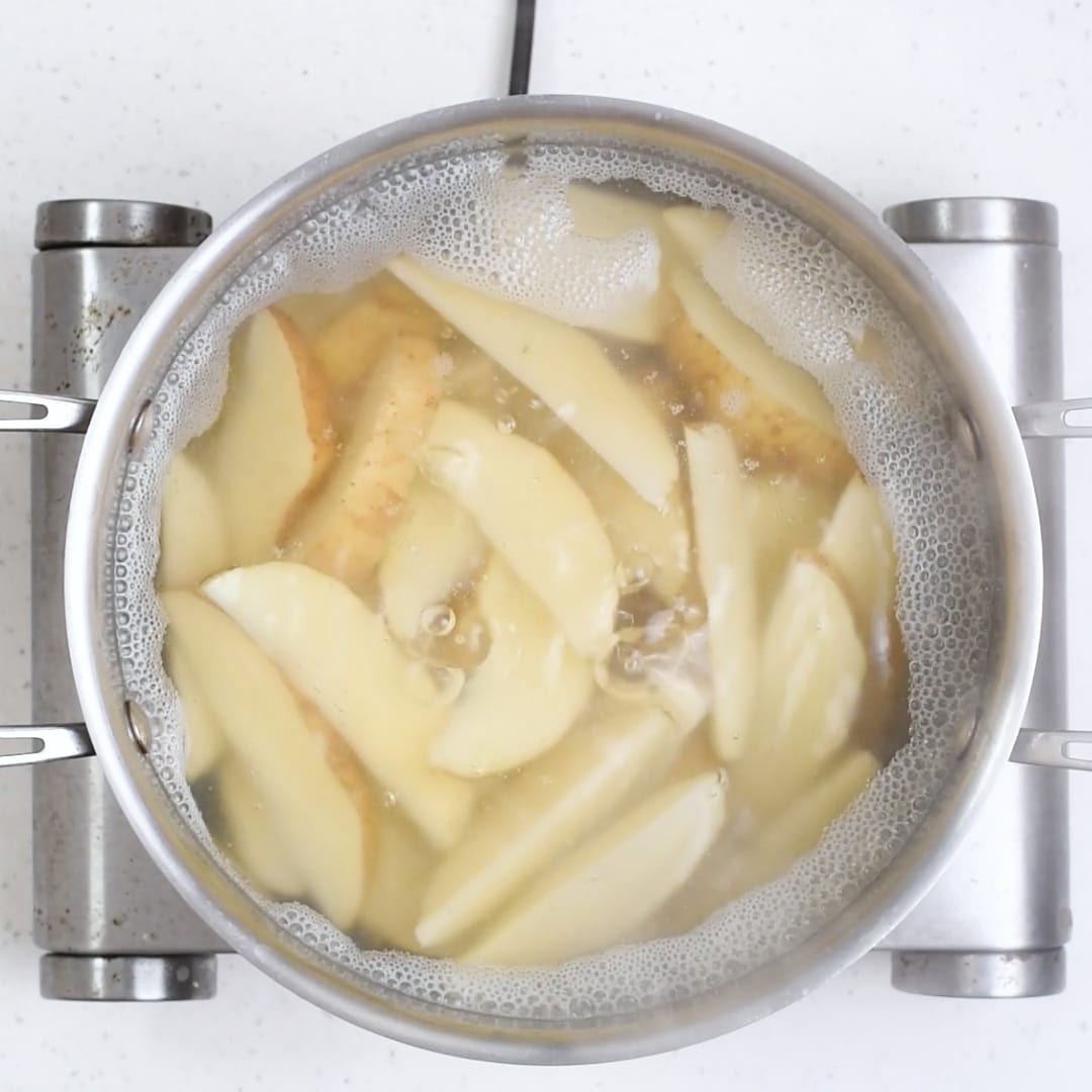 Cooking potatoes for Baked Greek Potato Wedges.