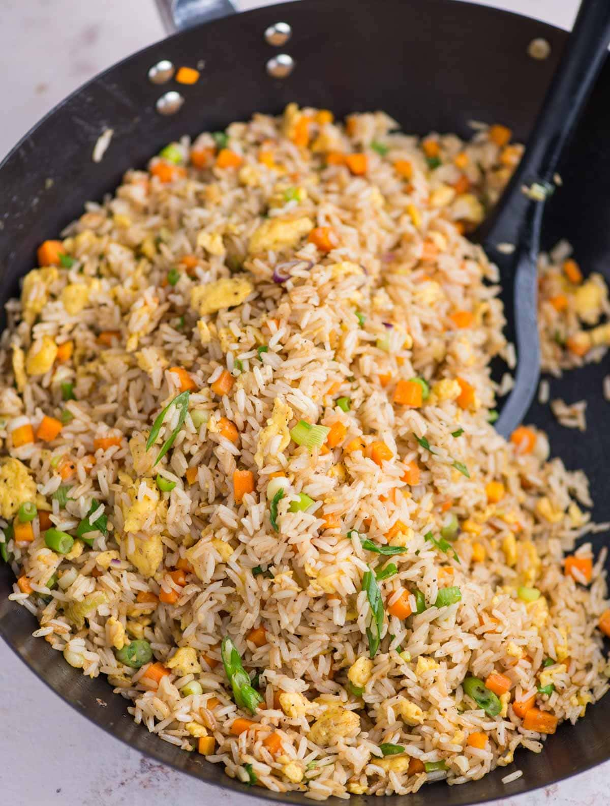 Fluffy egg rice with scrambled egg, crunchy vegetables is a one pan dinner recipe.