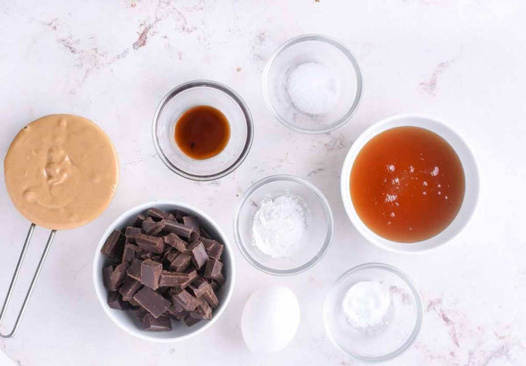 Ingredients for making soft peanut butter cookies.