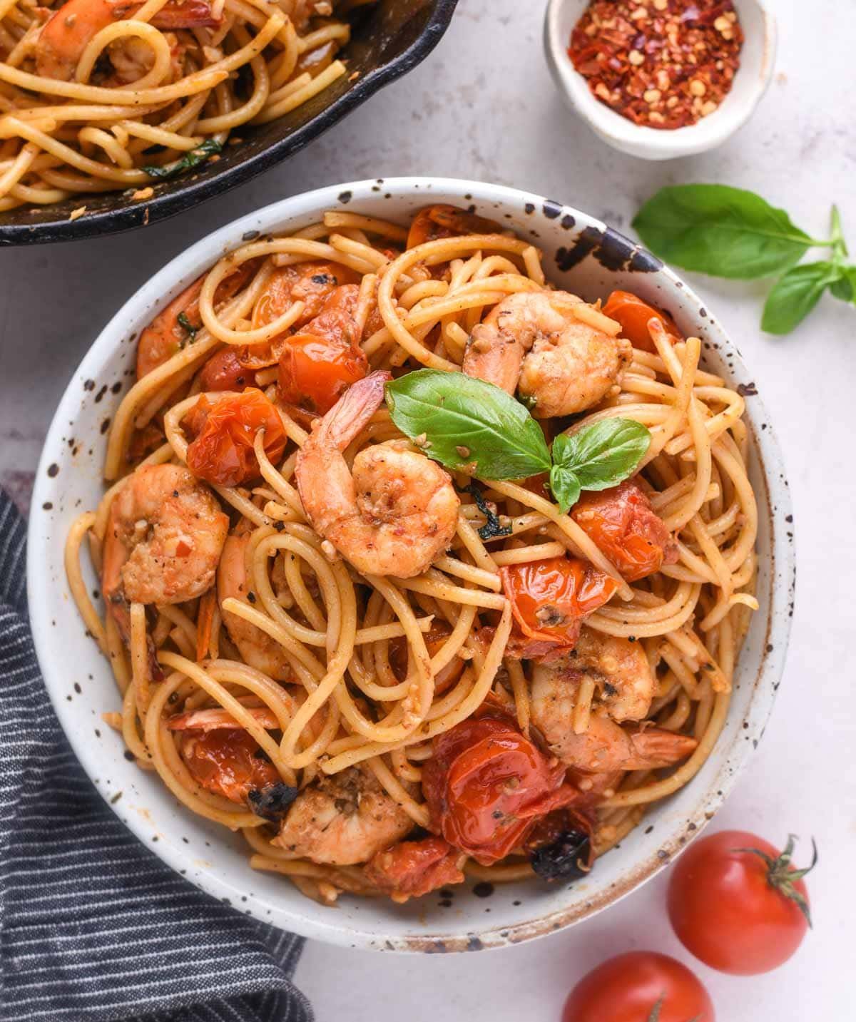 Cheery Tomato Pasta with shrimp has a summer vibe in it. Fresh cherry tomato, garlic, olive oil, lots of fresh basil, and shrimp, this tomato pasta is light and refreshing.