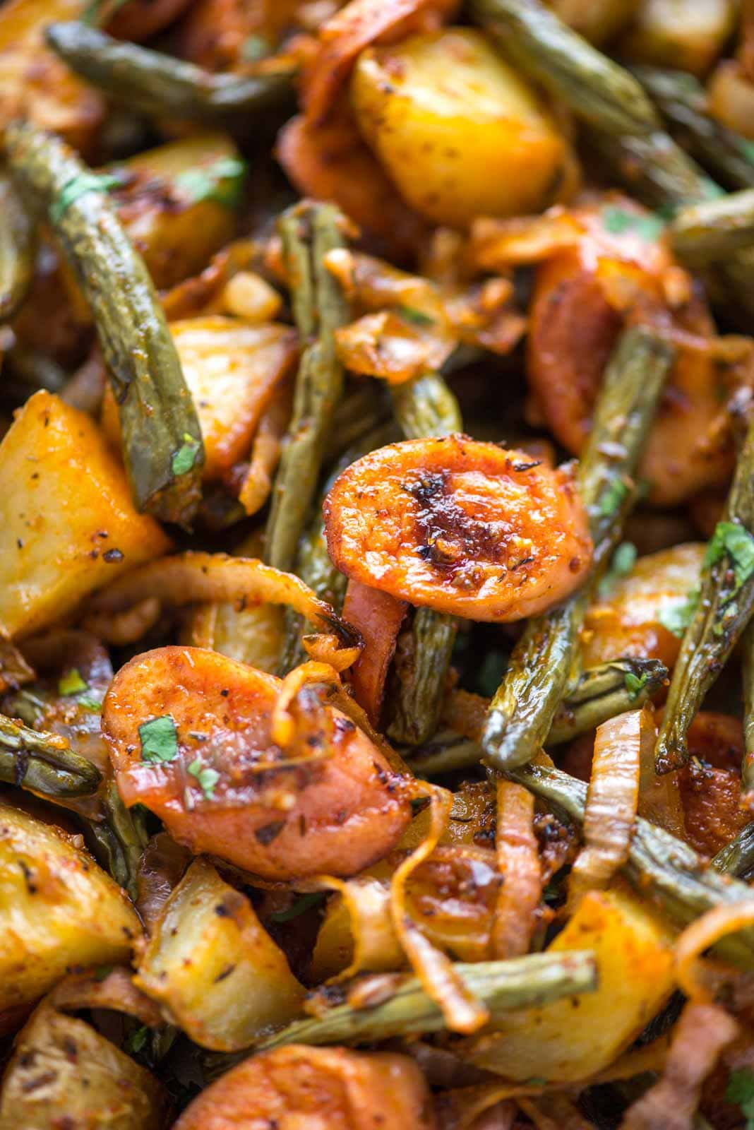 Sausage and potatoes- This super easy and delicious dinner is cooked in a Sheet pan with 10 minutes prep. Potatoes, sausage, green beans, and onion are tossed in a buttery dressing and baked to perfection.
