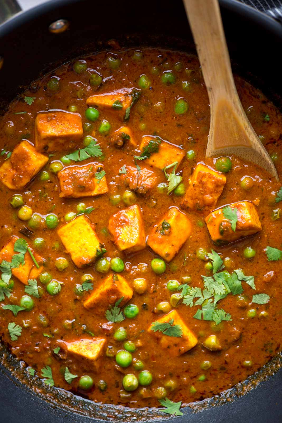 Soft paneer and matar in a flavorful onion tomato gravy, this recipe will remind you of your favorite restaurant for sure. Without any cream or cashew, this curry still is thick and perfect to scoop with roti or naan.