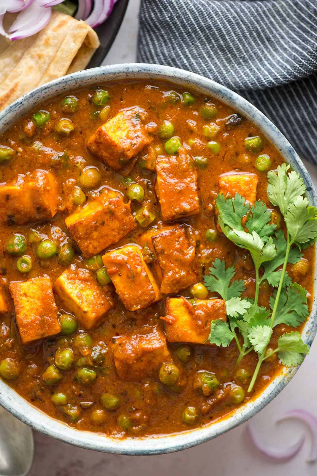 Soft paneer and matar in a flavorful onion tomato gravy, this matar paneer recipe will remind you of your favorite restaurant for sure. Without any cream or cashew, this curry still is thick and perfect to scoop with roti or naan.