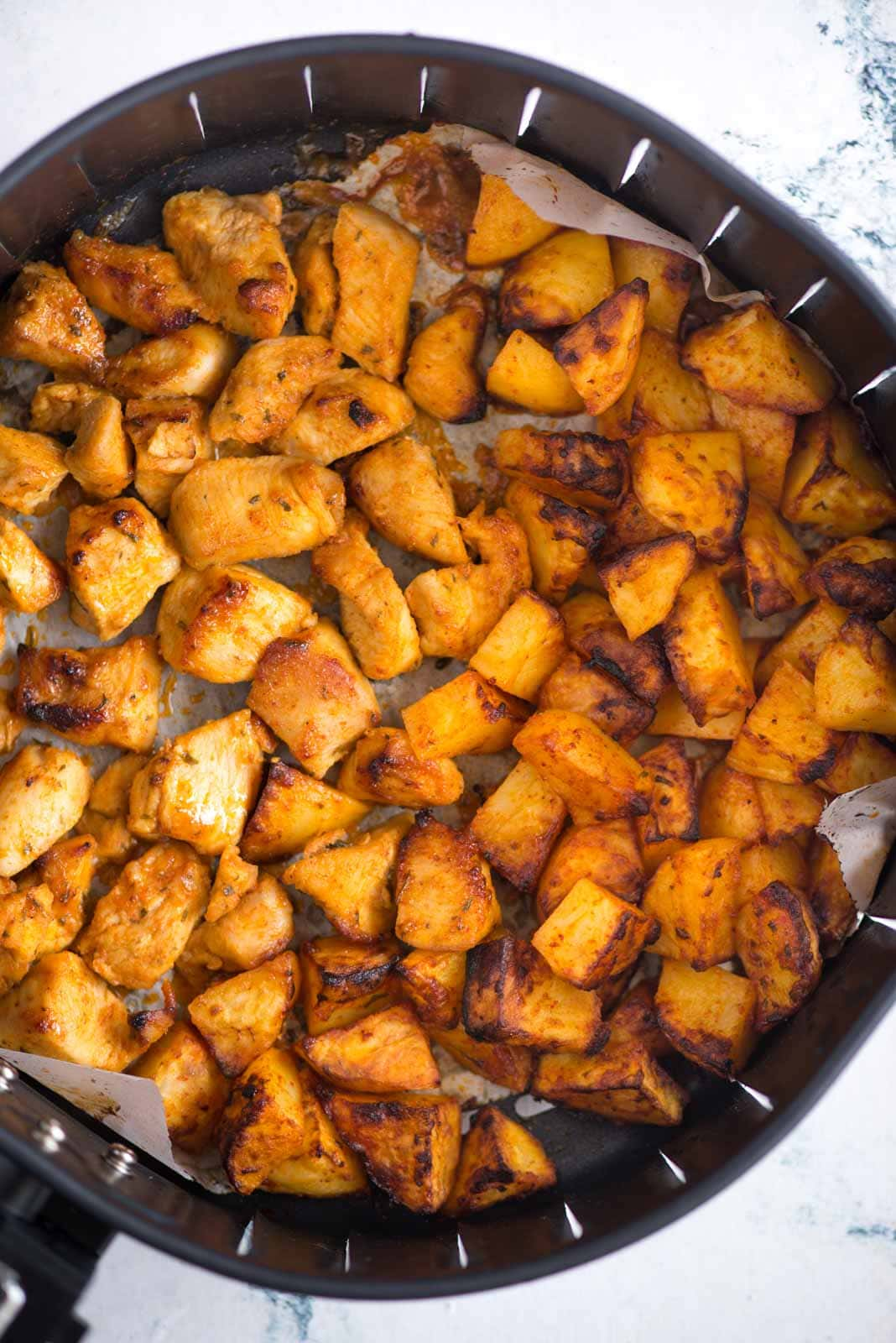 Airfryer Chicken and Potatoes - Boneless chicken breast, cubed potatoes are tossed in ranch dressing and air fried until roasted. This healthy dinner with very little oil is ready in just 30 minutes.