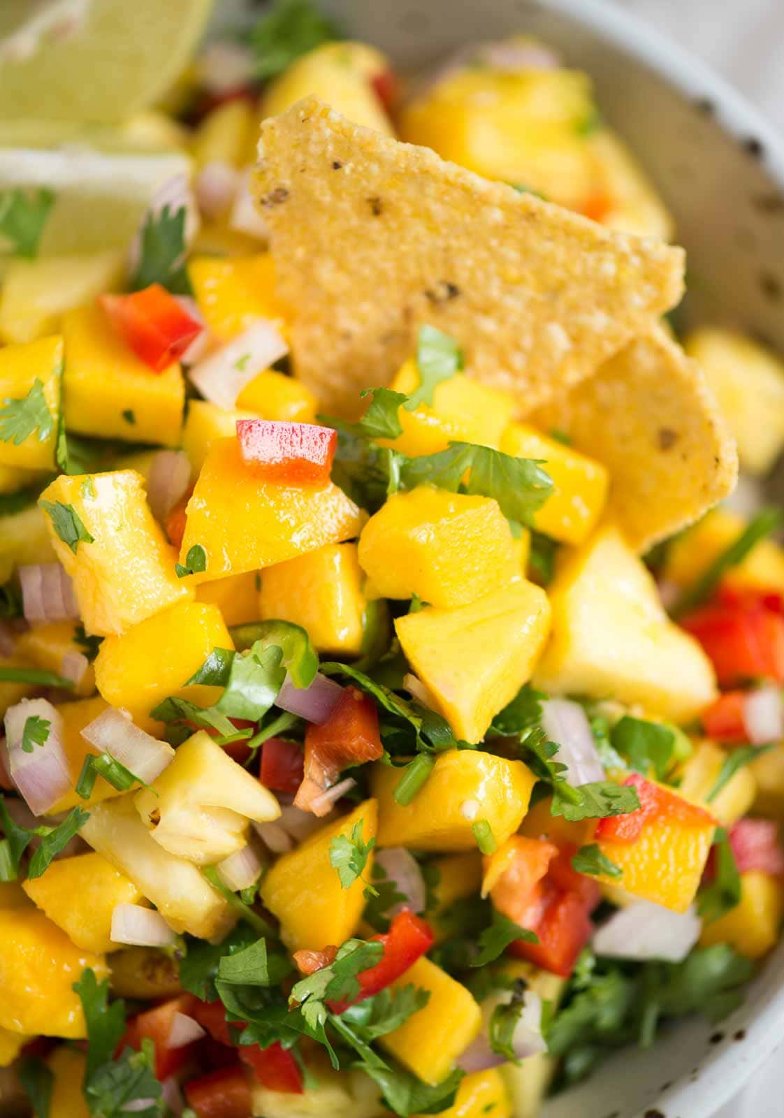 A sweet and spicy super easy salsa recipe that has two yum fruits - pineapple and mango. Pineapple Apple Salsa makes for the perfect summer treat with chips.