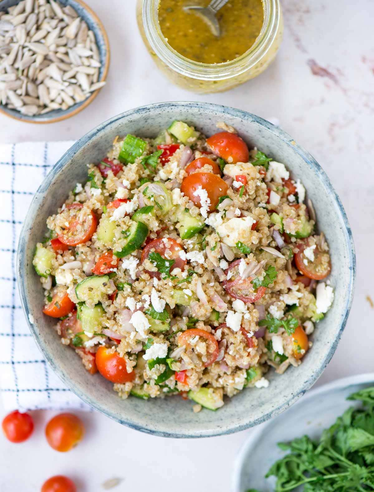 Bowl of Quinoa salad with fresh vegetables, herbs in a red wine vinaigrette