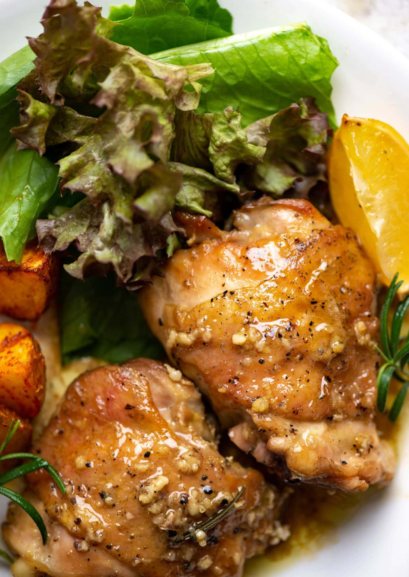 Perfectly baked chicken thighs with crispy skin and lots of lemon butter sauce to drizzle on.  Making this Lemon Chicken thighs recipe is really simple and fit perfectly in your mid-week dinner menu.