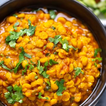 Close picture of chana dal served in a bowl with coriander leaves as garnishing